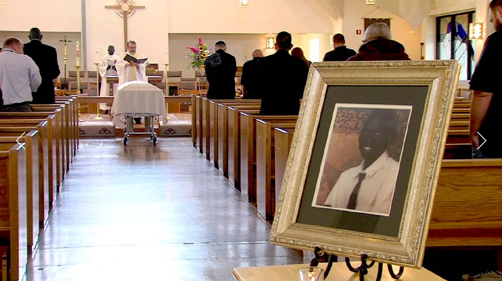 A portrait of Philip Deng Aguto was displayed at his funeral service in All Saints Episcopal Church in Salt Lake City on Friday, Aug. 26, 2016. (Courtesy/KUTV)