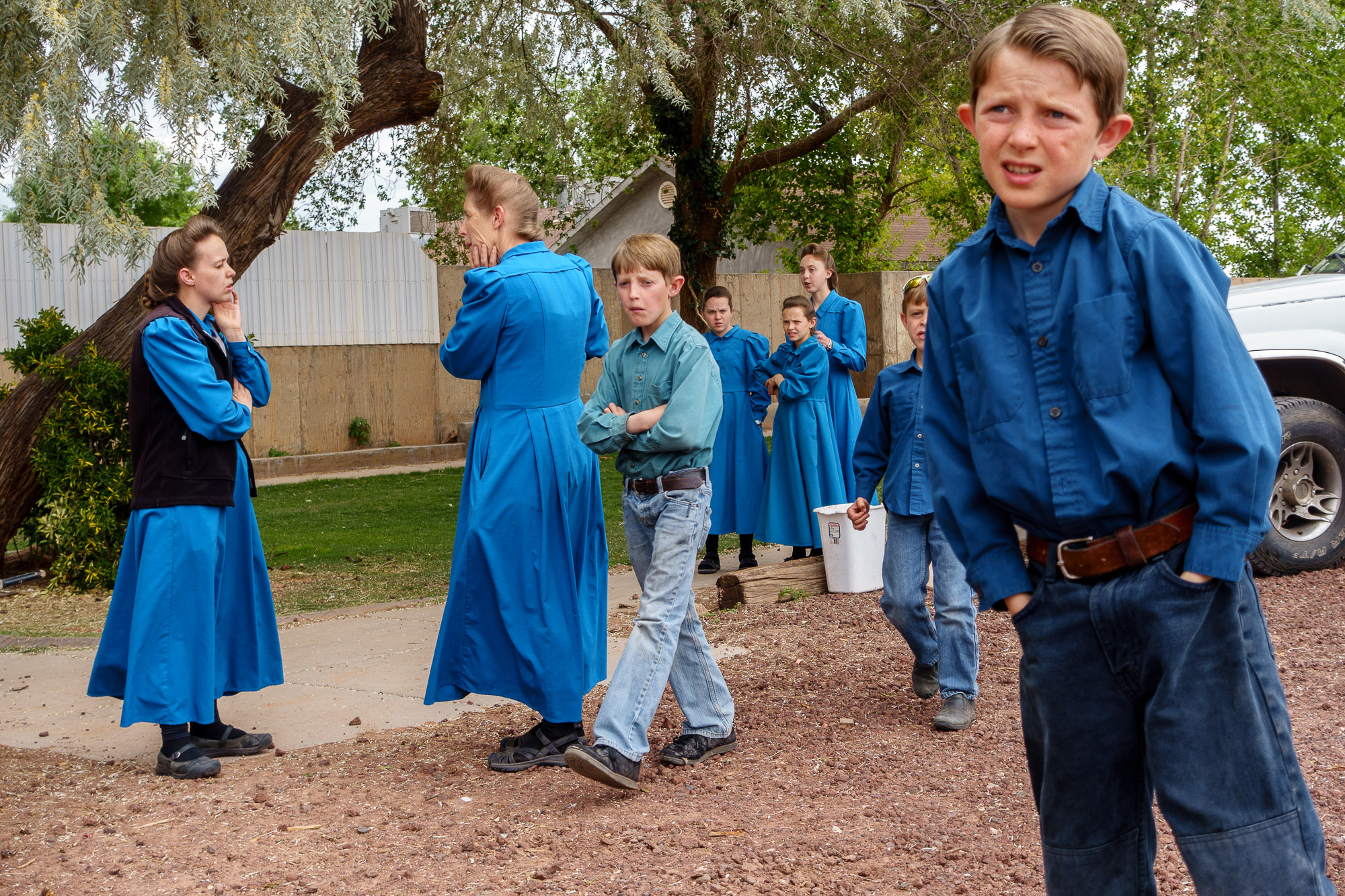 FLDS women and children stand in the yard of their Colorado City, Ariz., home as they are evicted.